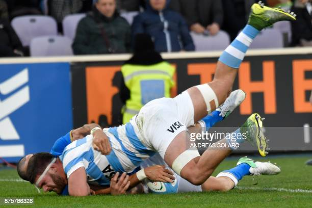 Argentina's second row Marcos Kremer scores a try despite the tackle of Italy's center Jayden Hayward during the International Rugby Union Test match...