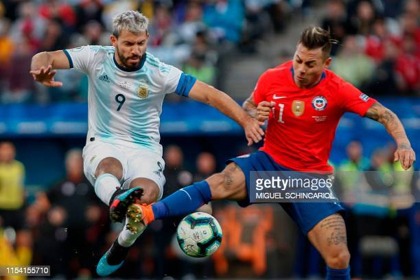 TOPSHOT Argentina's Sergio Aguero and Chile's Eduardo Vargas vie for the ball during their Copa America football tournament thirdplace match at the...