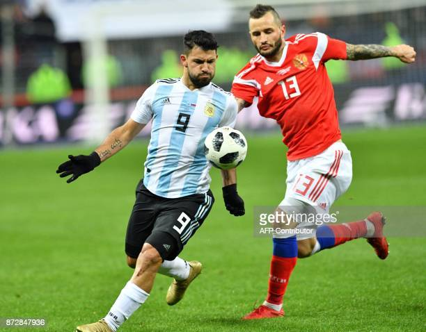 Argentina's Sergio Aguero and Russia's defender Fedor Kudryashov vie for the ball during an international friendly football match between Russia and...