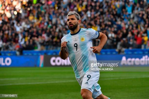 Argentina's Sergio Aguero celebrates after scoring against Chile during their Copa America football tournament thirdplace match at the Corinthians...