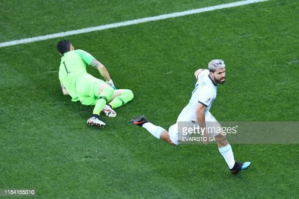 Argentina's Sergio Aguero celebrates after scoring past Chile's goalkeeper Gabriel Arias during their Copa America football tournament thirdplace...