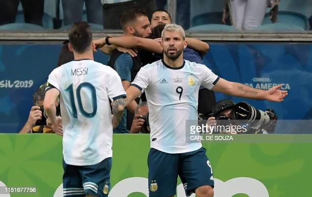 TOPSHOT Argentina's Sergio Aguero celebrates with Argentina's Lionel Messi after scoring against Qatar during their Copa America football tournament...