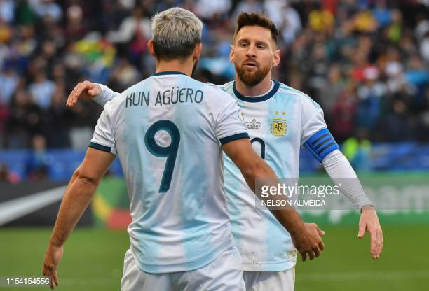 Argentina's Sergio Aguero celebrates with teammate Lionel Messi after scoring against Chile during their Copa America football tournament thirdplace...