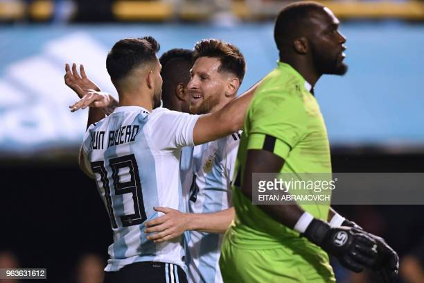 Argentina's Sergio Aguero celebrates with teammate Lionel Messi after scoring against Haiti during their international friendly football match at...