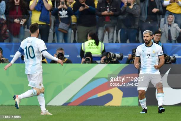 Argentina's Sergio Aguero celebrates with teammates after scoring against Chile during their Copa America football tournament thirdplace match at the...