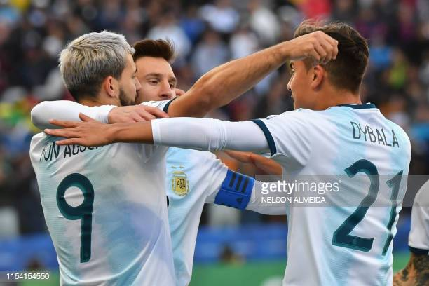 Argentina's Sergio Aguero celebrates with teammates Lionel Messi and Paulo Dybala after scoring against Chile during their Copa America football...