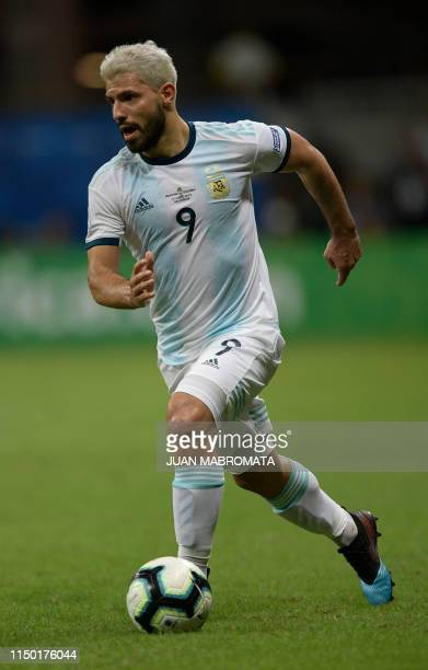 Argentina's Sergio Aguero drives the ball during the Copa America football tournament group match against Colombia at the Fonte Nova Arena in...