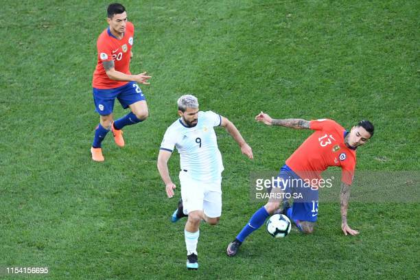 Argentina's Sergio Aguero is marked by Chile's Erick Pulgar during their Copa America football tournament thirdplace match at the Corinthians Arena...