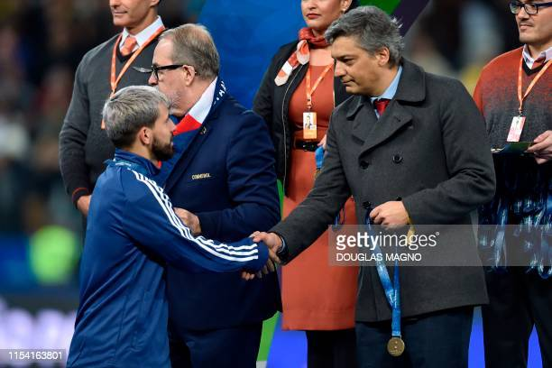 Argentina's Sergio Aguero receives the bronze medal after defeating Chile 21 in the Copa America football tournament thirdplace match at the...