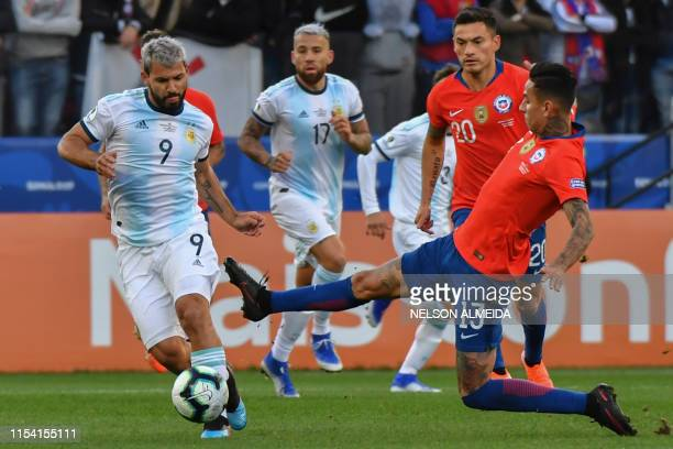 Argentina's Sergio Aguero si marked by Chile's Erick Pulgar during their Copa America football tournament thirdplace match at the Corinthians Arena...