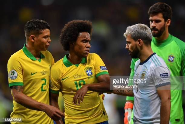 Argentina's Sergio Aguero speaks with Brazil's Willian and Brazil's Thiago Silva during their Copa America football tournament semi-final match at...