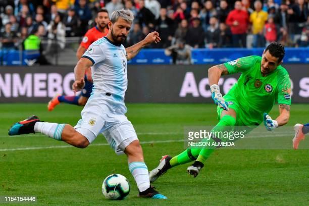Argentina's Sergio Aguero strikes the ball to score past Chile's goalkeeper Gabriel Arias during their Copa America football tournament thirdplace...