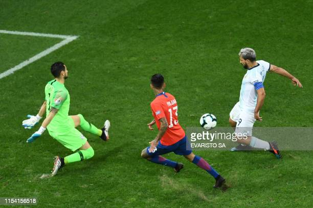 Argentina's Sergio Aguero tries to score against Chile during their Copa America football tournament thirdplace match at the Corinthians Arena in Sao...