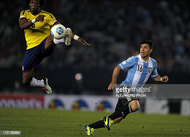 Argentina's Sergio Aguero vies for the ball with Colombia's Carlos Sanchez during the FIFA World Cup Brazil 2014 qualifying match at the Monumental...