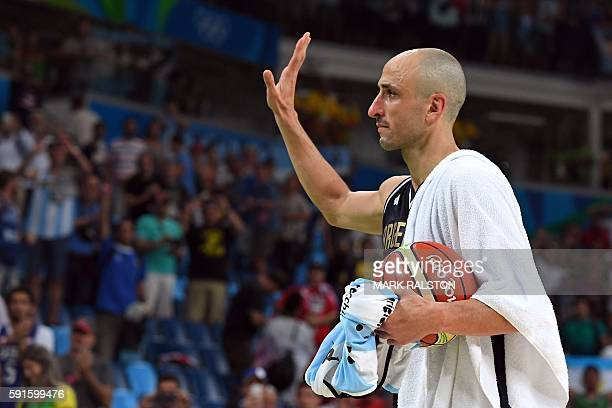 Argentina's shooting guard Manu Ginobili gestures as he leaves the court after losing to USA during a Men's quarterfinal basketball match between USA...