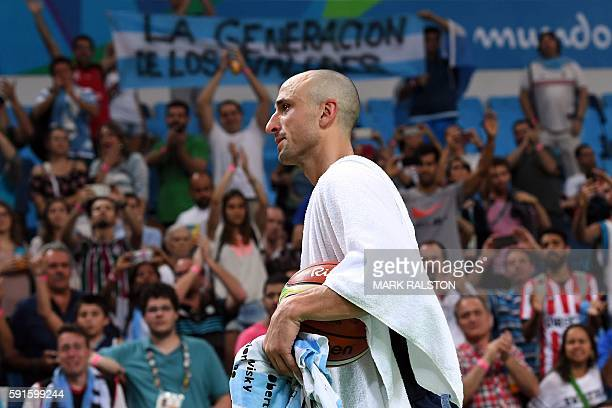 Argentina's shooting guard Manu Ginobili leaves the court after losing to USA during a Men's quarterfinal basketball match between USA and Argentina...