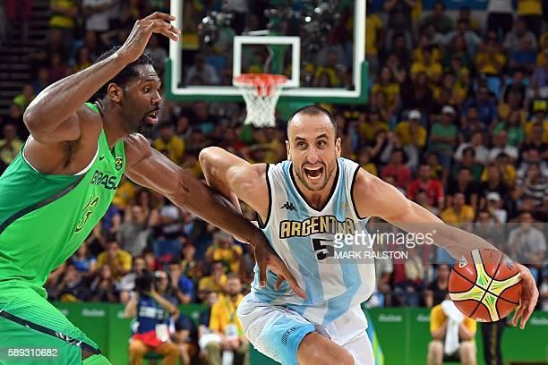 Argentina's shooting guard Manu Ginobili works around Brazil's centre Nene Hilario during a Men's round Group B basketball match between Argentina...