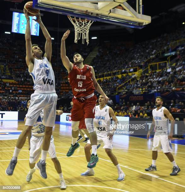 Argentina's shooting guard Nicolas Brussino vies for the ball with Mexico's center Israel Gutierrez during their 2017 FIBA Americas Championship...