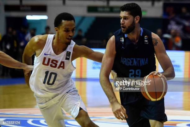 Argentina's small forward Patricio Garino drives the ball marked by USA's shooting guard Reggie Hearn during their 2017 FIBA Americas Championship...