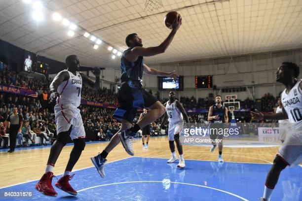 Argentina's small forward Patricio Garino shoots marked by Canada'spower forward Andrew Nicholson during their 2017 FIBA Americas Championship Group...