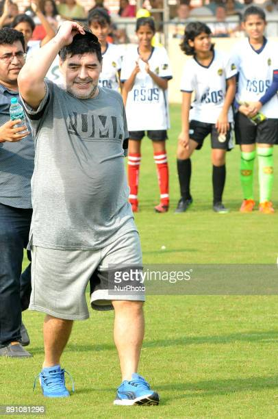 Argentina's soccer legend Diego Maradona gestures during a football workshop with school students in Barasat around 38 Km north of Kolkata on...
