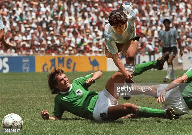 Argentina's soccer star team captain Diego Maradona evades a tackle from West Germany's Lothar Matthaus during the World Soccer Cup final won by...