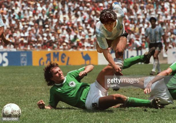 Argentina's soccer star team captain Diego Maradona evades a tackle from West Germany's Lothar Matthaus during the World Soccer Cup final, won by...
