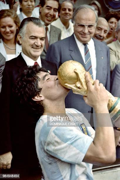 Argentina's soccer star team captain Diego Maradona kisses the World Soccer Cup won by his team after a 3-2 victory over West Germany on June 29,...