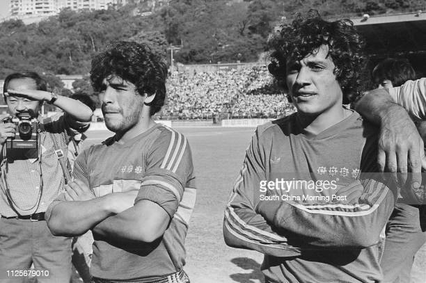 Argentina's soccer superstar Diego Maradona of Boca Juniors with his teammate at Hong Kong Stadium 10 Januayr 1982