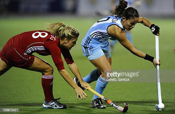 Argentina's Soledad Garcia battles for the ball with England's Helen Richardson during the field hockey Group B match for the Women World Cup 2010 in...