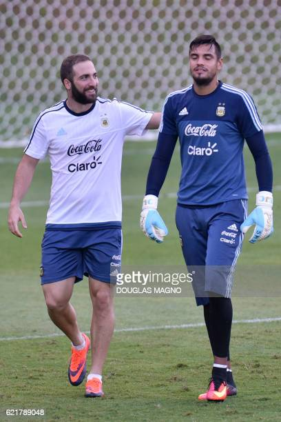Argentina's striker Gonzalo Higuain and goalkeeper Sergio Romero attend a training session of the national foorball team at the Atletico MG Training...