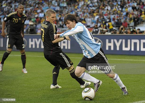 Argentina's striker Lionel Messi drives the ball past Germany's midfielder Bastian Schweinsteiger as Germany's defender Jerome Boateng looks on...