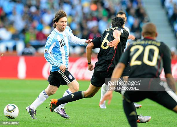 Argentina's striker Lionel Messi is marked by Germany's midfielder Sami Khedira and defender Jerome Boateng during their 2010 World Cup quarterfinal...
