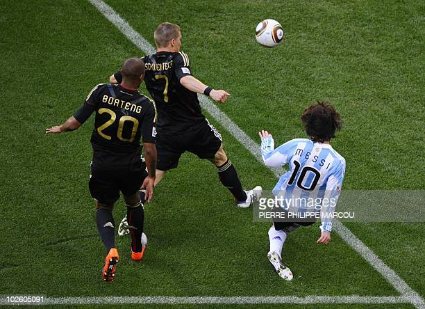 Argentina's striker Lionel Messi vies with Germany's midfielder Bastian Schweinsteiger and Germany's defender Jerome Boateng during the 2010 World...