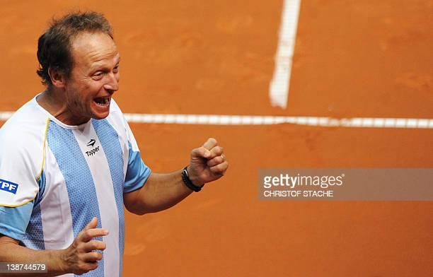 Argentina's team captain Martin Jaite celebrates after the doubles Davis Cup match victory of Argentinian Eduardo Schwank and his compatriot David...