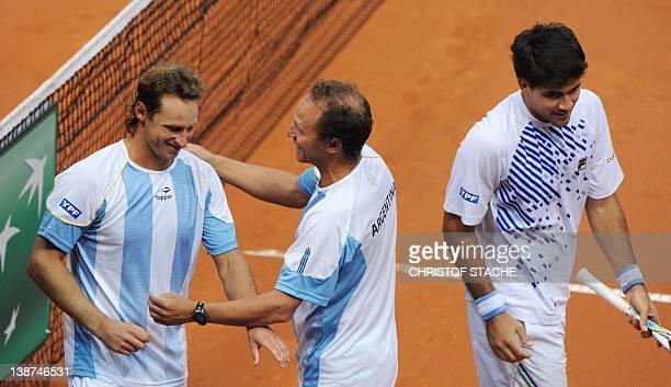 Argentina's team captain Martin Jaite congratulates Argentinian David Nalbandian and his compatriot Eduardo Schwank after their double Davis Cup...