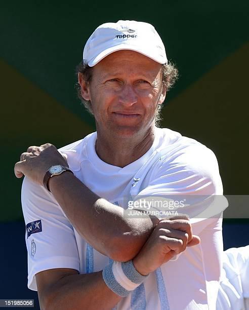 Argentina's team captain Martin Jaite gestures during the 2012 Davis Cup semifinals single tennis match between Argentina's tennis player Juan Monaco...
