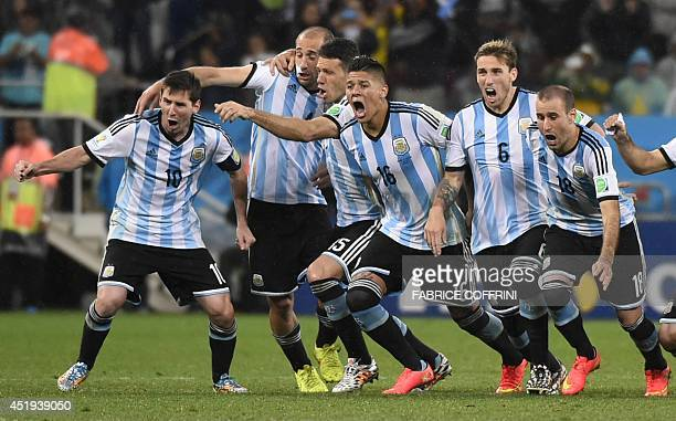 Argentina's team celebrate after winning their FIFA World Cup semifinal match against the Netherlands in a penalty shootout following extra time at...