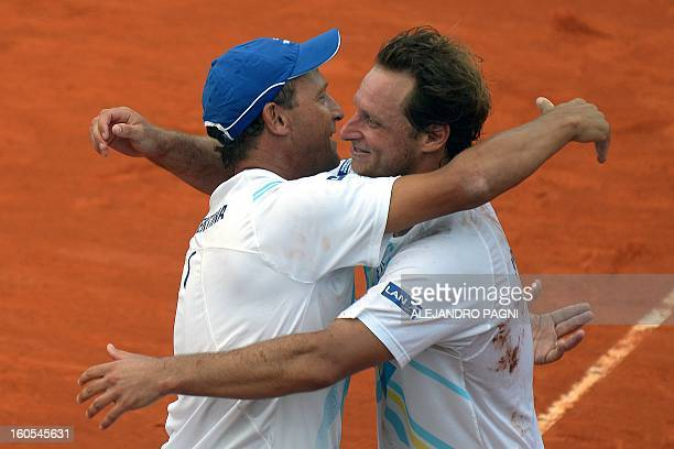 Argentina's tennis player David Nalbandian celebrates with team captain Martin Jaite after defeating Germany's players Christopher Kas and Tobias...