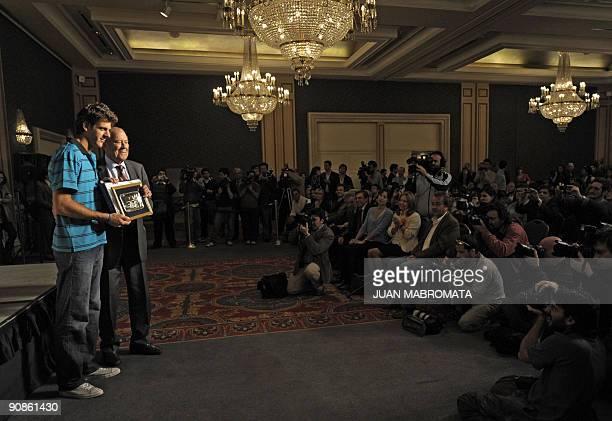 Argentina's tennis player Juan Martin Del Potro 2009 US Open Tennis Champion receives a commemorative plaque from Enrique Morea President of...