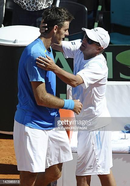 Argentina's tennis player Juan Martin Del Potro is congratulated by team captain Martin Jaite after winning the 2012 Davis Cup quarterfinal match...