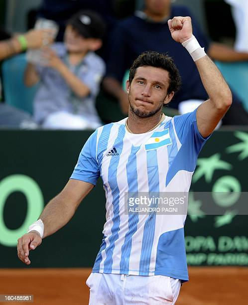 Argentina's tennis player Juan Monaco celebrates after defeating Germany's Florian Mayer in their 2013 Davis Cup World Group first round single...