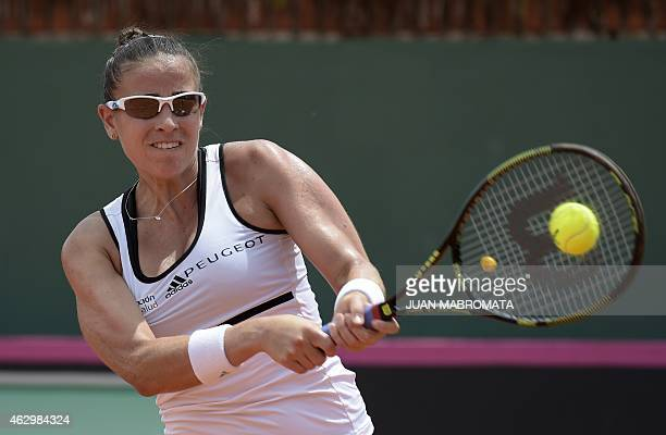 Argentina's tennis player Paula Ormaechea returns the ball US' tennis player Coco Vandeweghe the 2015 Fed Cup World Group II first round singles...