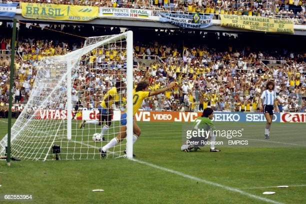 Argentina's Ubaldo Fillol and Alberto Tarantini dejected as goalscorer Zico and Serginho celebrate Brazil's first goal