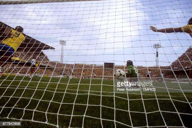 Argentina's Ubaldo Fillol dejected as goalscorer Zico and Serginho celebrate Brazil's first goal