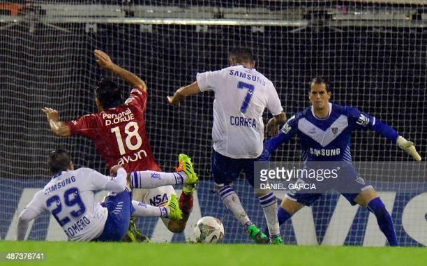 Argentina's Velez Sarsfield midfielder Lucas Romero knocks Paraguay's National midfielder Derlis Orue down while teammates forward Jorge Correa and...