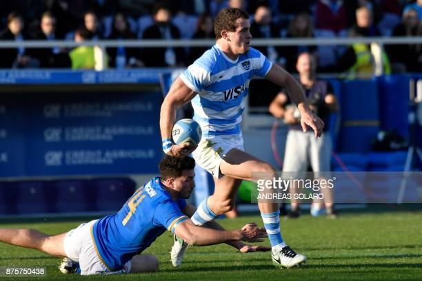 Argentina's wing Emiliano Boffelli escapes from the tackle of Italy's wing Leonardo Sarto during the International Rugby Union Test match between...