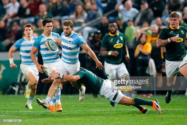 Argentina's wing Ramiro Moyano is tackled by South Africa's fullback Willie le Roux during The Rugby Championship rugby union match between South...