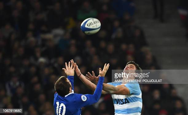 Argentina's winger Bautista Delguy jumps for the ball with France's flyhalf Camille Lopez during the international rugby union test match between...