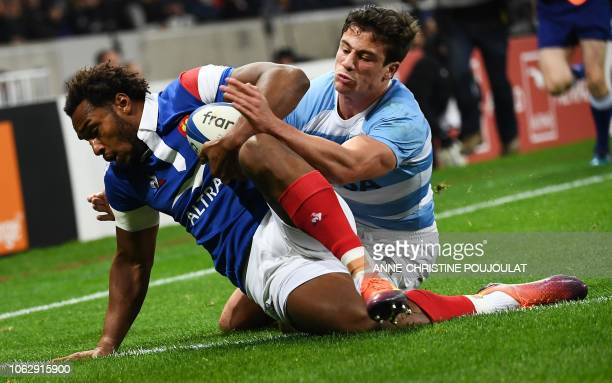 Argentina's winger Bautista Delguy tackles France's back row Benjamin Fall during the international rugby union test match between France and...